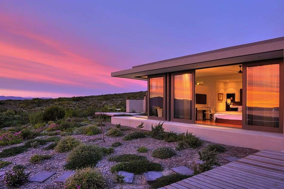 south-africa_grootbos-villa_pic836the-villa-lit-by-the-soft-light-of-sunset-lr